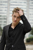 Handsome blond young man outdoor in city setting Royalty Free Stock Photography