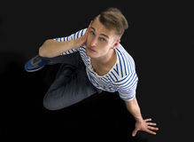 Handsome blond young man sitting, shot from above Royalty Free Stock Photo