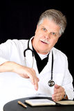 Handsome blue eyed mature medical doctor consultin Stock Images