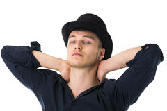 Handsome blue-eyed young man with black top-hat Stock Photography
