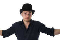 Handsome blue-eyed young man with black top-hat. Unsure expression Royalty Free Stock Photos