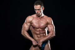 Handsome Body Builder Making Most Muscular Pose Royalty Free Stock Images