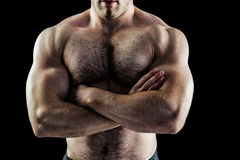 Handsome bodybuilder with arms crossed Stock Image