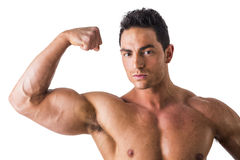 Handsome bodybuilder doing bicep pose, isolated on Stock Image