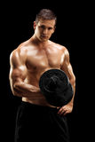 Handsome bodybuilder exercising with barbell Royalty Free Stock Image