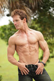 Handsome bodybuilder in the park Royalty Free Stock Photos
