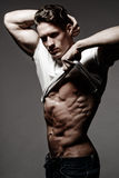 Handsome bodybuilder shows his great physique, perfect shoulders Royalty Free Stock Photography