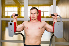 Handsome bodybuilder works out excercise in gym Stock Photo