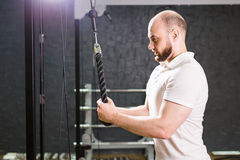 Handsome bodybuilder works out excercise in gym Royalty Free Stock Photo