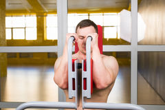 Handsome bodybuilder works out excercise in gym Royalty Free Stock Photography