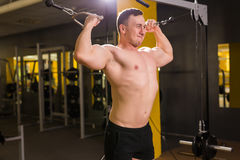 Handsome bodybuilder works out excercise in gym Royalty Free Stock Image