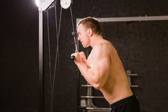 Handsome bodybuilder works out excercise in gym Stock Photos