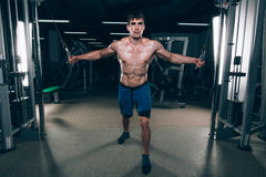 Handsome bodybuilder works out pushing up excercise in gym. Royalty Free Stock Photo