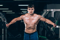 Handsome bodybuilder works out pushing up excercise in gym Royalty Free Stock Photography