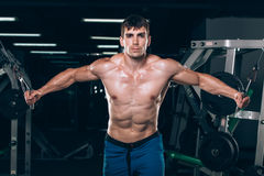 Handsome bodybuilder works out pushing up excercise in gym Royalty Free Stock Photo