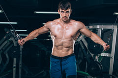 Handsome bodybuilder works out pushing up excercise in gym Stock Images