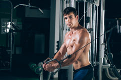 Handsome bodybuilder works out pushing up excercise in gym Royalty Free Stock Images