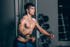 Handsome bodybuilder works out pushing up excercise in gym Royalty Free Stock Image