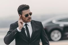 handsome bodyguard listening message with security royalty free stock photography