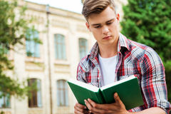 Handsome bookworm. Stock Images