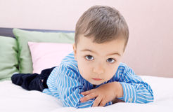 Handsome boy. Lying on the bed Stock Image