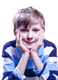 Handsome boy. Boy sitting on the chair holding head on his hands, isolated on white background Stock Image