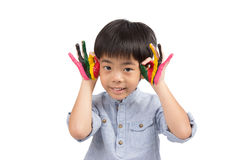 Handsome boy acting OK symbols with colorful painting Stock Image