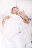 Handsome boy in bed Stock Photography