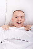 Handsome boy in bed at home a surprised face Royalty Free Stock Photography
