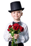 Handsome boy in classic suit with flowers isolated Stock Photos
