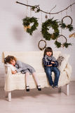 Handsome boy and cute small girl on Christmas background Stock Photography