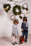 Handsome boy and cute small girl on Christmas background Stock Photo