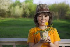 Handsome boy with dandelion flower summer outdoors.  Stock Photos