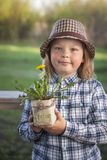 Handsome boy with dandelion flower summer outdoors.  Royalty Free Stock Images