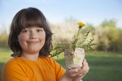 Handsome boy with dandelion flower summer outdoors.  Stock Photography