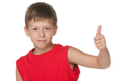 Handsome boy demonstrates thumb up Royalty Free Stock Image
