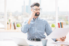 Handsome boy with document on phone Royalty Free Stock Photo
