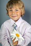 Handsome boy with flowers in hands Stock Photo