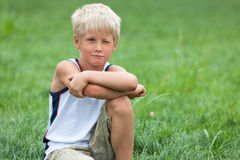Handsome boy on the green grass Royalty Free Stock Photography