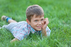 Handsome boy on the green grass Royalty Free Stock Images