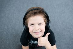 Handsome boy in headphones royalty free stock photography