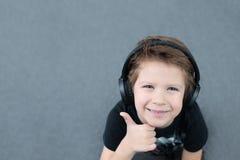 Handsome boy in headphones stock image