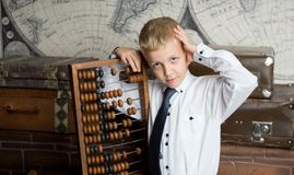 Boy love count. Handsome boy holding big ancient wooden abacus calculation. conceptual idea about modern education system. a guy dreams of his future profession Stock Image