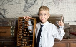 Boy love count. Handsome boy holding big ancient wooden abacus calculation. conceptual idea about modern education system. a guy dreams of his future profession Stock Photo