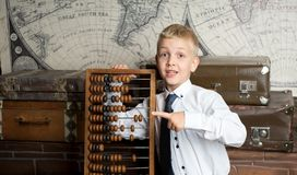 Boy love count. Handsome boy holding big ancient wooden abacus calculation. conceptual idea about modern education system. a guy dreams of his future profession Royalty Free Stock Image