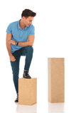 Handsome boy with a leg on a box Royalty Free Stock Photography