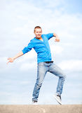Handsome boy making dance move Stock Images