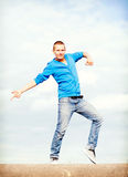Handsome boy making dance move Stock Photography