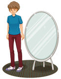 A handsome boy beside a mirror Royalty Free Stock Photo