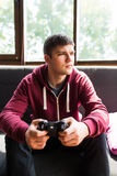 Handsome boy plaing video games Royalty Free Stock Photo